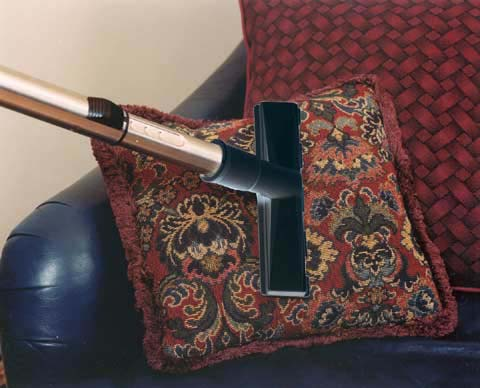 vibrating upholstery tool in use