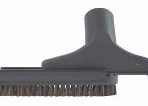 Upholstery tool with slide brush